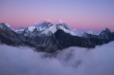 A beautiful scenery of the summit of Mount Everest covered with snow under the white clouds